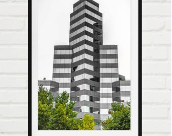 Urban glass building growing among trees - signed print