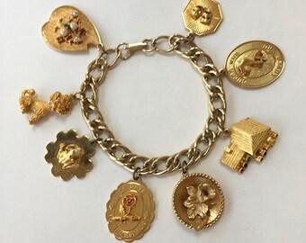Vintage gold tone double link charm bracelet 7 charms