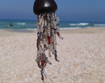 Handmade ceramic beaded jellyfish necklace with hamsa.