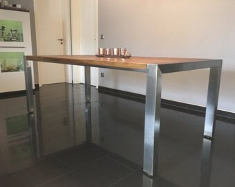 Stainless steel dining table with oak top