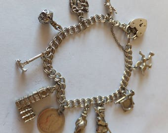 Vintage sterling silver charm bracelet with 10 charms from London