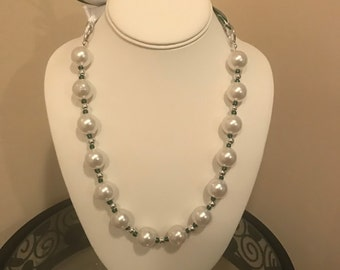 The Savannah.  Glass pearl necklace with green and white ribbons for the ties.