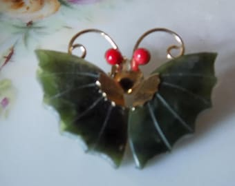 Beautiful vintage green jade butterfly brooch with red coral on the antennae. It is real jade with nice carving.