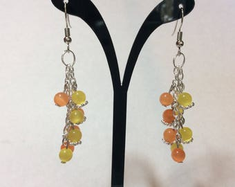 "Earrings ""Orange and yellow cat eyes chained"""