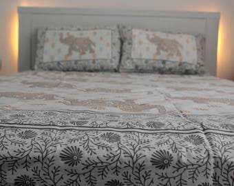 Grey and gold elephant print bed sheet
