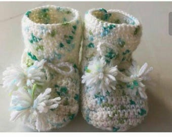 Crocheted baby booties made