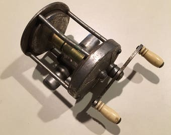 Lot of four antique fishing reels