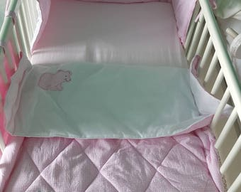 Hand quilted baby cot quilt.