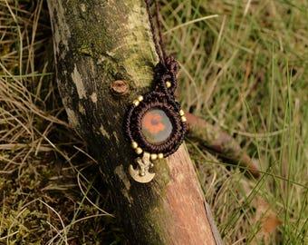 Brown ancestors earrings with orange flower
