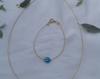 necless and braselet gold string to ward off evil