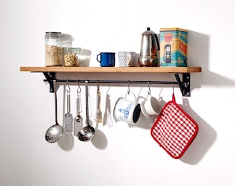 Kitchen shelf processes from old rustic oak and raw steel by hand