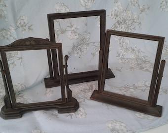 Vintage wood frames on pivot stands
