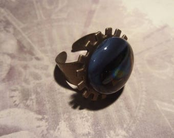 Steampunk style brass cog Ring with fused glass decoration; purple/black/iridescent.