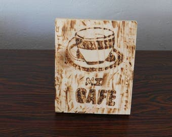 Cup of coffee in pyrography.