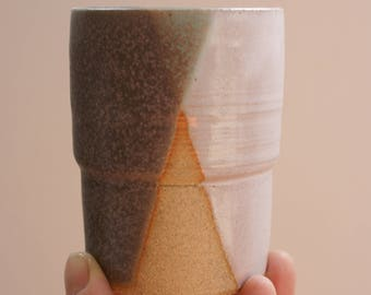 Grey and white espresso cup or shot glass with raw unglazed areas