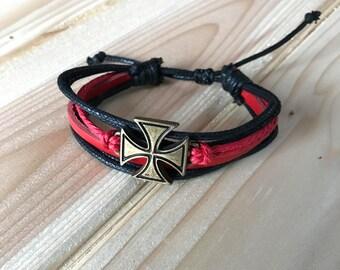 Batted Cross Leather Bracelet