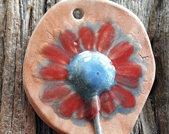 Rustic Daisy Pendant Ceramic Stoneware with Red and Purple Petals and Blue Center by Mary Harding