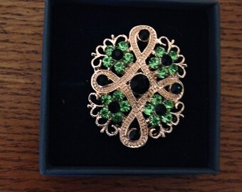 magnetic brooch, green rhinestones