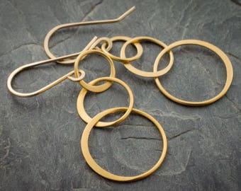 Bubbles Gold Vermeil Hoop Earrings. Dangle Hoop Earrings. Circle Earrings. Interlocking Circles. Interlocking Hoops.