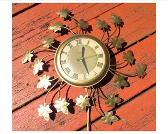 Vintage Electric Wall Clock, Gold, Metal Leaves by United Clock Co., 60s, leaf, starburst, Roman numeral dial