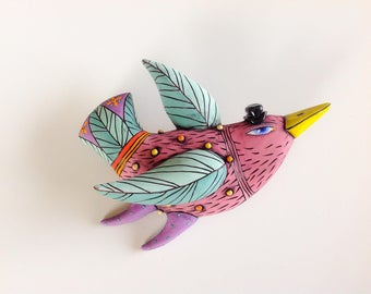 Maroon Bird With Yellow Beak