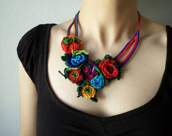 Fiber art necklace with red, yellow, purple, blue, and green freeform crocheted flowers - Adonis Annua - RESERVED
