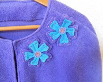 Woman's dark lavender appliquéd fleece cape, capelet or bed jacket.