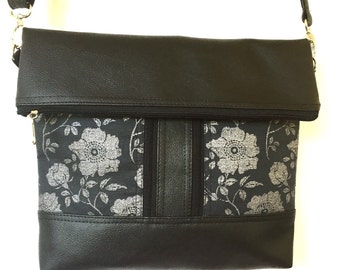 Cross body zipper bag featuring black and silver floral print