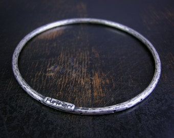 Made to order rustic bangle bracelet with dots and hammered finish. Deep patina, strong and simple.
