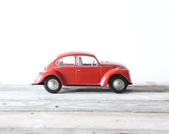 Red Metal Volkswagon Beetle Bug
