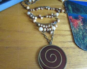 swirl necklace drape