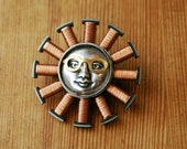 Motor Winding Sunburst Sprite Brooch