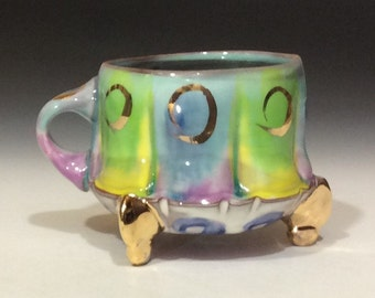 Colorful little gold footed coffee mug