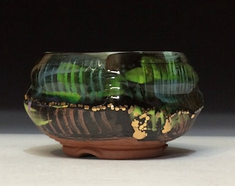 Black and copper green chawan with gold luster hand trimmed bottom