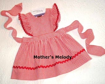 Red Gingham Pinafore Dress or Jumper with flutter sleeves.   Made to order in sizes 3, 4, and 5.  Trimmed in red rick rack.