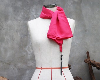 Pink chiffon weighted scarf with metal tassel charm