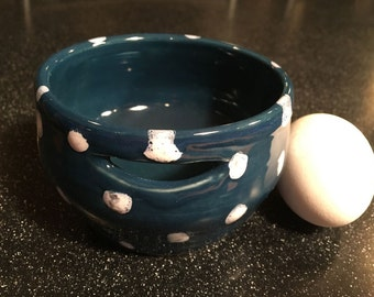 dark blue ceramic egg separator with white polka dots