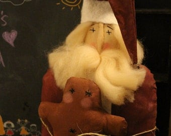 Primitive Santa with gingerbread