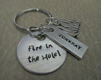 fire in the hole! - hand stamped overwatch junkrat inspired keychain with fire charm