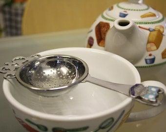 Metal vintage tea strainer with Blackpool crest, serving, tea ware