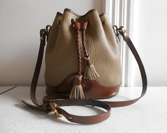 Authentic Dooney and Bourke Drawstring Handbag Taupe and Brown Leather/Suede Crossbody Handbag