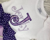 Purple camo monogram large initial snap-tee, snap-suit, bodysuit, one piece Lavender camo camouflage, Purple dots choice of name and letter