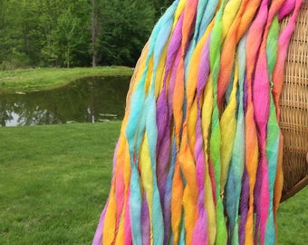 Super bulky handspun rainbow yarn, 54 yards and 3.2 ounces/ 91 grams, spun thick and thin in merino wool