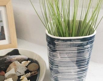 medium porcelain planter screen printed pattern lines in blue.