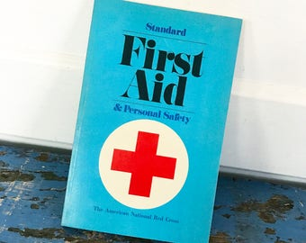 Vintage American National Red Cross Standard First Aid Personal Safety Illustrated Blue Book 1977