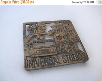 20% OFF SALE RETRO Hot Plate, vintage 1960s Universal Studios brass trivet - Hollywood souvenir with film crew, movie sets, & movie stars