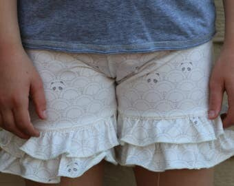 cream shorties with subtle panda bear print.  sizes 12m - 14 years.  fabric by Art Gallery