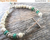 BLACK FRIDAY SALE Inspirational Silver Plate Sideways Cross Bracelet Green Turquoise and White Howlite beads, silver tone spacer beads, adju