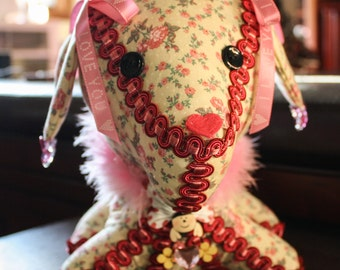 Decorative Stuffed Dog in Yellow with Pink Flowers and Fuzzy Boa