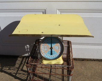 Vintage Yellow Baby Scales.